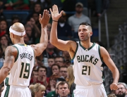 MILWAUKEE, WI - NOVEMBER 14: Jerryd Bayless #19 high fives teammate Greivis Vasquez #21 of the Milwaukee Bucks during the game against the Cleveland Cavaliers on November 14, 2015 at BMO Harris Bradley Center in Orlando, Wisconsin. NOTE TO USER: User expressly acknowledges and agrees that, by downloading and or using this Photograph, user is consenting to the terms and conditions of the Getty Images License Agreement. Mandatory Copyright Notice: Copyright 2015 NBAE (Photo by Gary Dineen/NBAE via Getty Images)